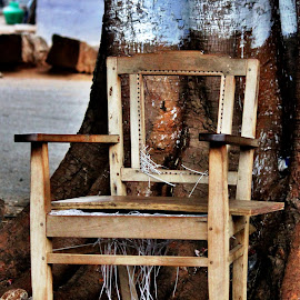 Please take your seat... by Anoop Namboothiri - Artistic Objects Furniture ( chair, old, wooden, street, abndoned, under a tree, anoop namboothiri, antique, decaying,  )