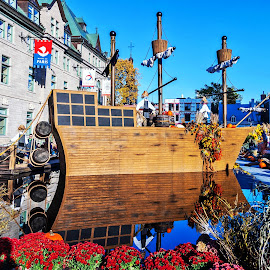 Anchored boat in the Jardins of the City Hall of Quebec city by Réjean Côté - City,  Street & Park  City Parks ( city hall, jardins, canada, quebec city, boat, water blue )