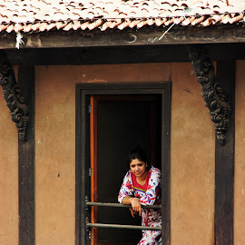 Lady looking through window by Thakkar Mj - Buildings & Architecture Architectural Detail ( single window, building, window, lady, heritage,  )