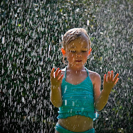 Soaking it all in by David Prentice - Babies & Children Children Candids ( blue, soak, white, togs, reain drops, summer, emotive, dance, light, amelie. rain, rain drop )