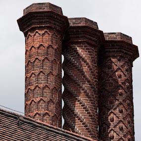 by Debbie Salvesen - Buildings & Architecture Architectural Detail ( early 20th century, spirals, europe, geometric shapes, decorative architecture, brandenburg, brick, germany, architecture, postdam, rosettes,  )