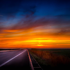 Highway of the sun by Adrian Ioan Ciulea - Landscapes Sunsets & Sunrises ( leading lines, sky, highway, sunset, street, darkness, sun, fall, color, colorful, nature )