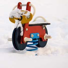 A toy in the snow by Anitta Lieko - Artistic Objects Toys ( red, wheel, toy, snow, white, number )