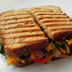 Hot tasty paninis served daily on gluten-free bread. Pictured here, seasonal flavor