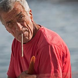 fisherman in the port of Lipari by Tore Johan Birkeland - People Portraits of Men ( port, lipari, fisherman, man,  )