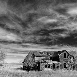 Ghostly reminder by Joel Schwader - Landscapes Prairies, Meadows & Fields ( sky, old farms, prarrie, buildings, south dakota )