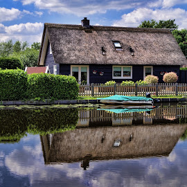 Kinderdijk II by Stefano Landenna - Buildings & Architecture Homes ( clouds, kinderdijk, holland, reflections, boat )