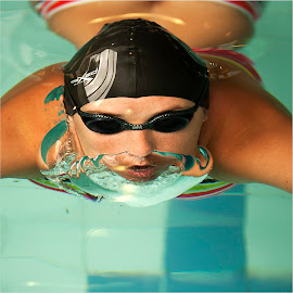 breaking the surface by Maricha Knight van Heerden - Sports & Fitness Swimming ( butterfly, natural light, turqoise water, bathing cap, goggles, local pool, breathing, bikini, swimming, swimmer, training, bubble, blue, breath )