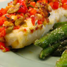 Baked white fish with Onions, Peppers, Olives, and Feta