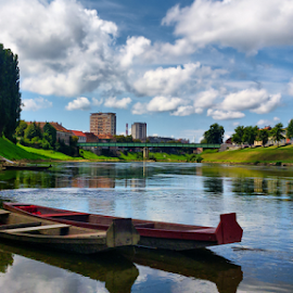 Karlovac from river bank by Oliver Švob - City,  Street & Park  Neighborhoods ( clouds, sky, karlovac, kupa, boats, croatia, town, boat, place, river, city,  )