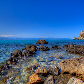 rocks in the Bay of Sant'Antonio by Carmelo Parisi - Landscapes Waterscapes