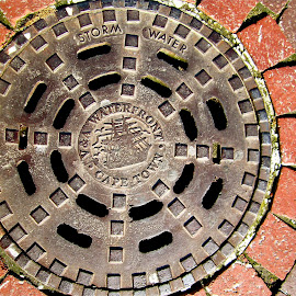 Sewer Cover in Cape Town, South Africa by Tyrell Heaton - Artistic Objects Industrial Objects ( sewer cover challenge, south africa, cape town,  )