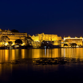 Udaipur in Blue Hour by Amit Aggarwal - Landscapes Travel ( reflection, ghat, waterscape, blue hour, udaipur, rajasthan, city palace, india, lake pichola, yellow, landscape )