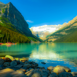 Lake Louise by Joseph Law - Landscapes Waterscapes ( glacier, lake louise, blue sky, in banff national park, green, rocky  mountains, trees, reflections, rocks )