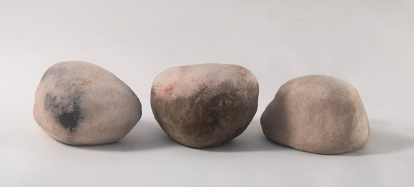 Three Rocks <br> Stoneware, open pit fired <br> 5.5 x 24 x 8 in