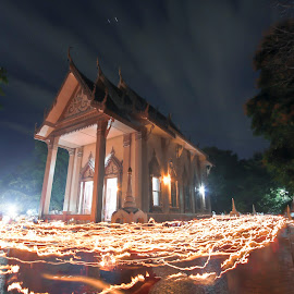 light way of candle at temple by iPhotoIndy Studioo - Buildings & Architecture Other Exteriors ( clouds, moon, monk, iphotoindy, candlelight, star, thailand, way, thai, temple, candle, time, full, lapse, timelapse, candles, candle light, festival, full moon, light, bhuda )