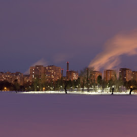 Winter in the city by Daniel Ciolac - City,  Street & Park  City Parks ( winter, night photography, park, ice, buildings, night, smoke, nightscape, city )