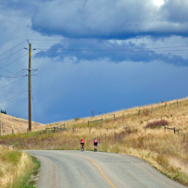 Uphill Climb by Keith Sutherland - Landscapes Travel ( clouds, hill, sky, bikers, bikes, road, storm, race )