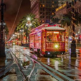 New Orleans Street Car 1 by Sheldon Anderson - City,  Street & Park  Street Scenes ( new orleans, night photography, louisiana, street car, reflections, rain,  )