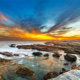Glorious Skies by Clive Wright - Landscapes Sunsets & Sunrises ( orange, sunset, sea, rock, ocean )