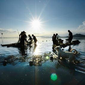 Fishermen of Taal lake by Jeremy Mendoza - People Professional People ( work, fishermen, taal_lake, summer, philippines, , Earth, Light, Landscapes, Views, #GARYFONGDRAMATICLIGHT, #WTFBOBDAVIS )