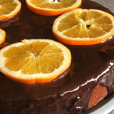 Orange Cake Topped With Chocolate Sauce