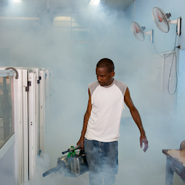 Man Fumigating Against Mosquitos by Robert Machado - News & Events Health ( mosquitos, chikungunya virus, mosquito, no, fumigating, insects, insect, people, intoxicating, fignting, fumes, fight against, fumigate, medicine, working, man, animal, work, protection, control, aedes aegypti, cuban, exterminator, treater, fumigation, means, without, chikungunya, fumigator, flea, pest, bug, dengue, cuba, Urban, City, Lifestyle )