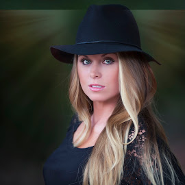 Woman in a hat by Carole Brown - People Portraits of Women ( blonde hair, black lace top, black hat, green eyes, light )