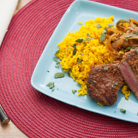 Minute Steaks with Picadillo-Style Sauce & Yellow Rice