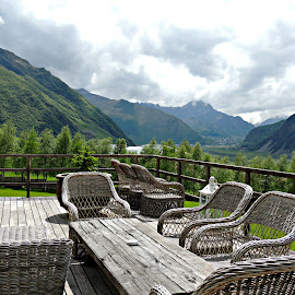 Landscape with Wicker Chairs by Tamsin Carlisle - Landscapes Mountains & Hills ( republic, terrace, mountains, europe, chairs, georgia, trees, patio, table, landscape, caucasus, caucasian, Chair, Chairs, Sitting,  )