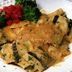 Black and White Lobster Ravioli in a Seafood Cream Sauce