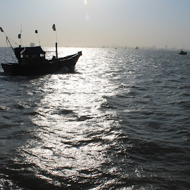 Towards the sun! by Srivenkata Subramanian - Landscapes Travel ( mumbai, sea, boat, evening, sun,  )
