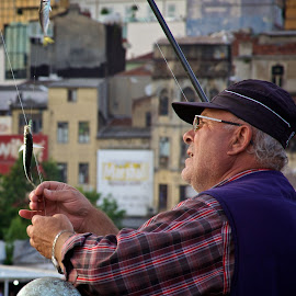 Concentration by Joel Estby - People Street & Candids ( street, candid, bridge, turkey, istanbul, fisherman, people, city,  )