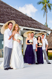 Newlyweds and party with parasols