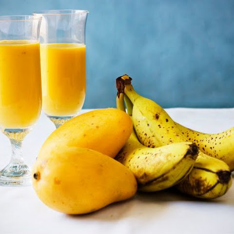 Banana-Mango Smoothies With Seeds, Milk and Fruits