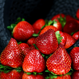 by Dipali S - Food & Drink Fruits & Vegetables ( picking, fruit, red, sweet, antioxidant, strawberry, closeup, picnic, hat, berries )