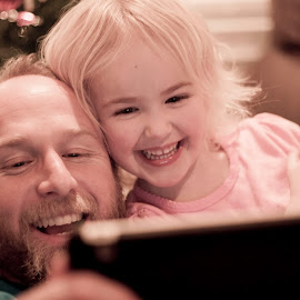www.rocktheshotforum.com  I'm a brand new photographer and this is one of the first ones I took of my husband and youngest daughter skyping with family in Florida. by Mary Carter Leach - People Family