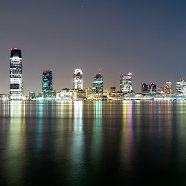 New jersey SkyLine by Vaibhav Jain - City,  Street & Park  Skylines ( water, longshot, skyline, new, sky, colors, jersey, camera, line, night, photography, new jersey skyline, , purple, yellow, color )