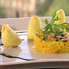 Mediterranean Squid (calamari) filled with Shellfish, Saffron Risotto and Ink Sauce