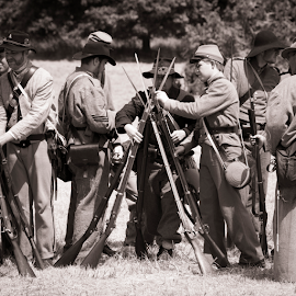 Storing rifles for quick and easy access... by Tina Stanley - News & Events US Events ( canteen, guns, soldiers, soldier clothing, civil war, civil war re-enactment,  )