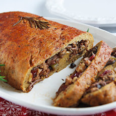 Seitan Roast Stuffed with Walnuts, Dried Cranberries, and Mushrooms
