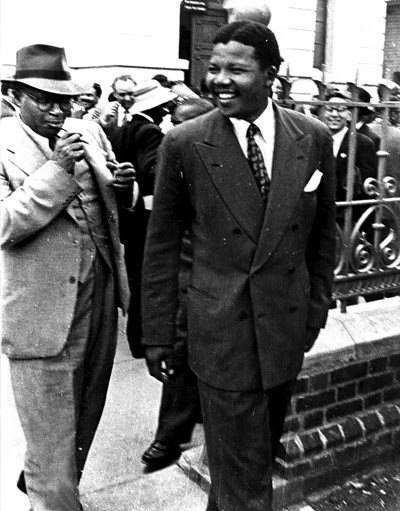 FACING DOWN THE ENEMY Nelson Mandela quickly rose to leadership positions within the ANC (African National Congress). By the late 1950's he was a prominent public figure and a thorn in the apartheid regime's flesh. His work as an attorney with OR Tambo in South Africa's first black legal firm mostly involved in defending black victims of the Apartheid system. As Volunteer-in-chief in the 1952 defiance campaign, he led thousands to break apartheid laws. He was frequently arrested and banned.