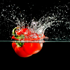 A perfect splash by Vineet Johri - Food & Drink Fruits & Vegetables ( water, vkumar, red, splash, drops, pepper, vegetable )