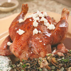 Pomegranate-Glazed Cornish Game Hens with Wild Rice-Chestnut Stuffing and Yogurt Sauce