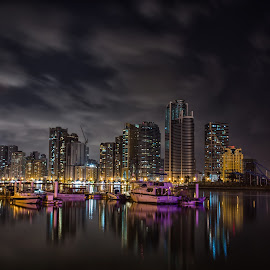City of dreams by Prakash Singh - City,  Street & Park  Skylines ( clouds, reflection, skyline, uae, buildings, long exposure, night, light, city,  )