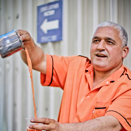 Orange and Blue by Galli Levy - People Portraits of Men ( orange, blue, street, juice, istanbul, man, orange. color )