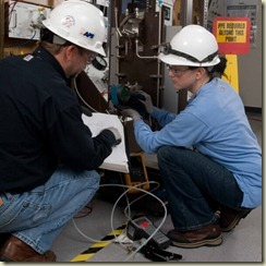 Picture of employees performing maintenance during a 2008 refueling outage at Palo Verde nuclear station.