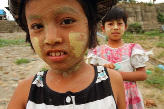 Young Myanmar girls with Thanaka on their faces