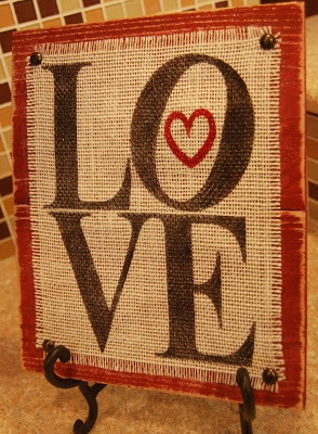 love plaque with burlap and wood