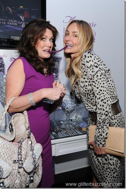Lisa Vanderpump and Taylor Armstrong  with candy
